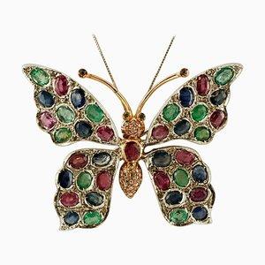 Broche ou pendentif papillon en or rose 9k et argent, diamant, rubis, émeraude et saphir bleu