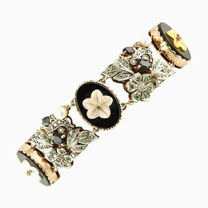 Diamonds, Sapphires, Pearl, Gold and Silver Bracelet