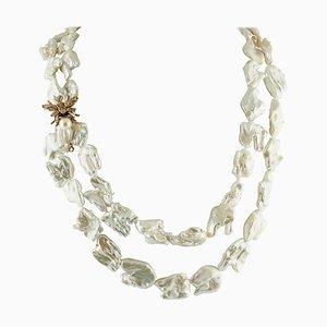 Collier avec fermoir en argent et en or rose avec perle baroque, diamants noirs et grenat