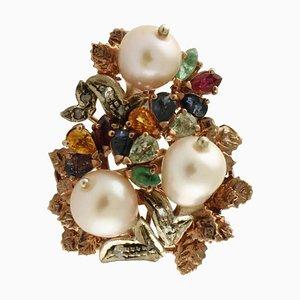 Bague en grappe de rubis, saphir, topaze, perle, diamant, argent et or