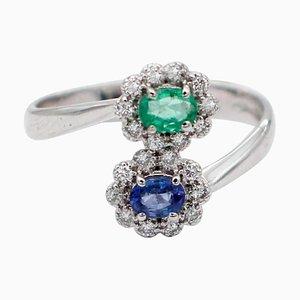 18 Karat White Gold Contrarié Ring with Emerald, Sapphires & Diamonds