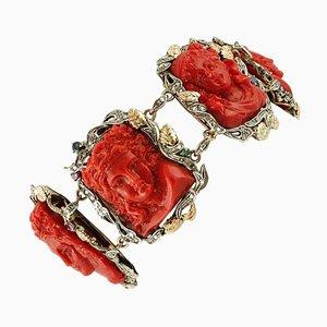 Bracciale a maglie in oro e argento con facce incise su corallo rosso, diamanti, rubini e zaffiri
