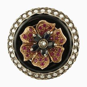 Blumenring aus Roségold und Silber mit Diamanten, Rubinen, Australischem Blauem Saphir & Onyx