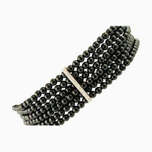 Weißgold Perlen Armband mit Onyx & Diamanten