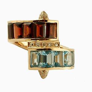 Diamonds, Light Blue Topazes, Garnets and 14K Yellow Gold Ring