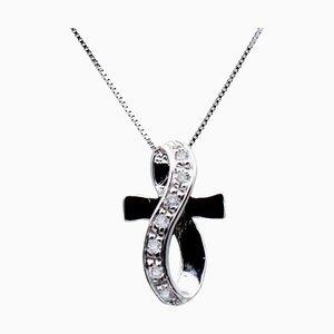 Collar con colgante de cruz estilizada de oro blanco de 18 kt