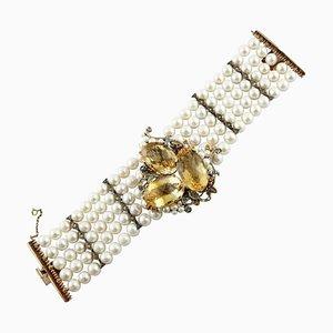 Bracciale artigianale con diamanti, rubini, smeraldi, zaffiri, topazio, perle, oro rosa e argento