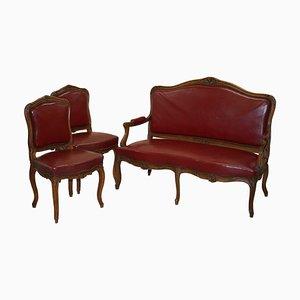 Poltrone e divano in pelle color rosso scuro, Francia, set di 3