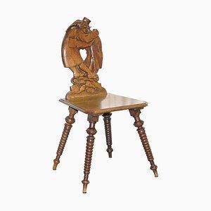 Black Forest Carved Oak Bobbin Hall Chair Depicting Two Friends Hugging