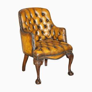 Poltrona Chesterfield in pelle marrone con gambe a zampa