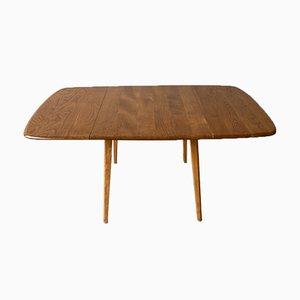 Mesa de comedor abatible con tablero de madera de Ercol