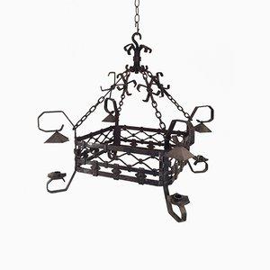 Lámpara de araña de hierro forjado con cuatro brazos, años 40