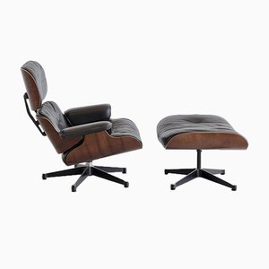 Lounge Chair and Footstool by Charles & Ray Eames for Vitra, 1970s, Set of 2