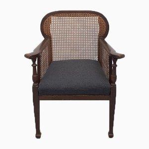Colonial Armlehnstuhl aus Holz und Schilfrohr