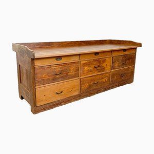 Banco de trabajo de panadería industrial vintage de madera de pino con cajonera