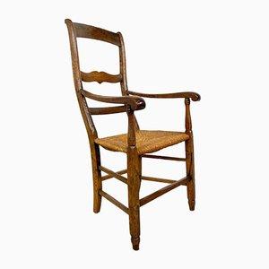 Antiker Armlehnstuhl aus Eiche mit Sitz aus Schilfrohr, 19. Jh