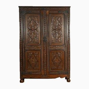 Mobiletto da ingresso in legno di quercia pesantemente intagliato