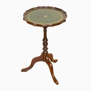 Portapiante o tavolino in legno con base tripode e ripiano in pelle verde