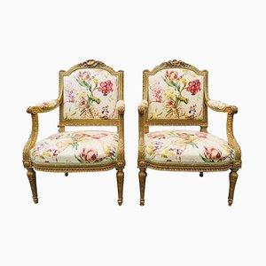 Französische Armlehnstühle aus vergoldetem Holz, 19. Jh., 2er Set
