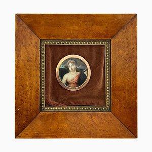 Immagine con cornice in legno di una giovane principessa e un grande uccello da preda
