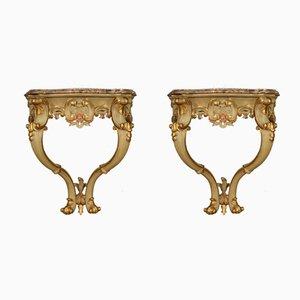 Italienische lackierte, vergoldete und bemalte Konsolen mit Marmorplatten, 20. Jh., 2er Set