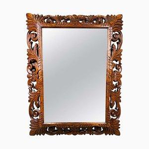 Spiegel mit Rahmen aus geschnitztem Mahagoni, 19. Jh