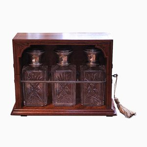 Rosewood and Amboyna Inlaid Tantalus Revealing 3-Cut Glass Decanters with Continental Silver Trims & Lids 1800s