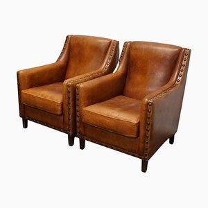 Sillones Club holandeses vintage de cuero color coñac. Juego de 2
