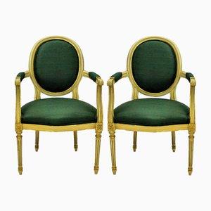 Butacas francesas estilo Luis XV doradas, años 50. Juego de 2