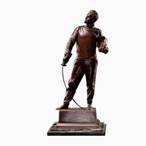 Estatua de esgrimista de bronce patinado de G. Devreese (1861-1941)