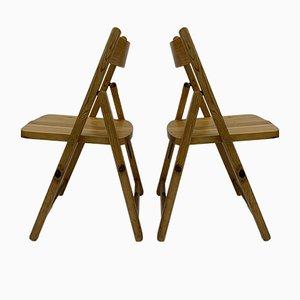Sillas plegables de madera de pino, años 70. Juego de 2