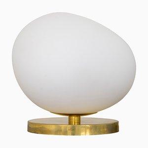 Lampada da tavolo in vetro opalino a forma di pietra con base in ottone