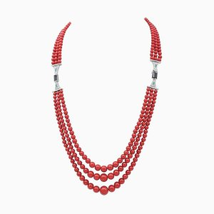 Collana in corallo, smeraldo, diamanti e onice