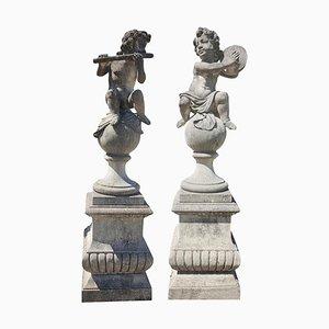 Estatuas de jardín de piedra Putto italianas en representación de músicos. Juego de 2