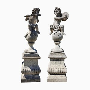 Italian Putto Stone Garden Statues Representing Musicians, Set of 2