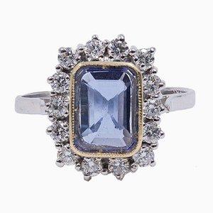 18K Gold Ring with Central Tanzanite and Brilliant Cut Diamonds