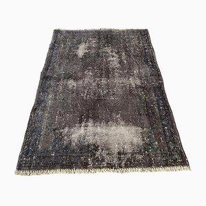Überfärbter türkischer Vintage Teppich aus grauer Wolle