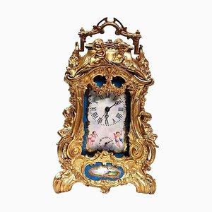 Uhr aus vergoldeter Bronze und Porzellan