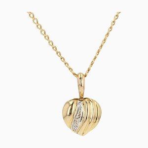 Collier avec pendentif en forme de coeur et diamant en or jaune 18 carats