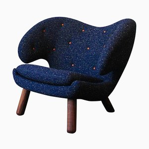 Pelican Chair in Fabric and Wood with Buttons by Finn Juhl