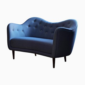 Sofá modelo 46 de madera y tela de Finn Juhl