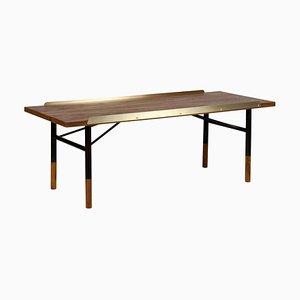 Tisch aus Holz und Messing von Finn Juhl
