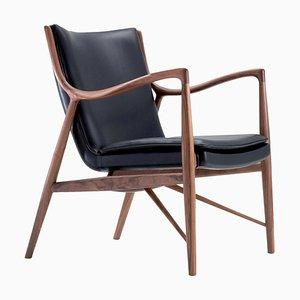 45 Stuhl aus Holz und schwarzem Leder von Finn Juhl