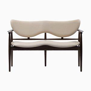 48 Sofa aus Holz und Leder von Finn Juhl