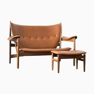 Chieftain Sofa mit Hocker aus Holz und Leder von Finn Juhl