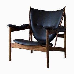 Chieftain Armlehnstuhl aus Holz und schwarzem Leder von Finn Juhl