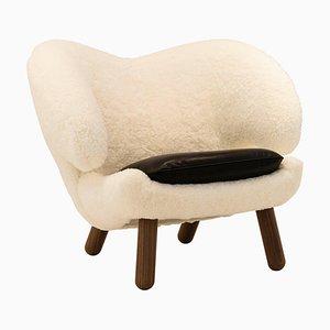 Pelican Stuhl aus Skandilock Schaf und Schwarzem Leder von Finn Juhl