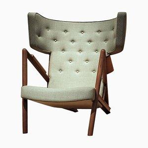 Grasshopper Armlehnstuhl aus Holz und Stoff von Finn Juhl