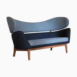 Sofá Baker de madera y tela de Finn Juhl