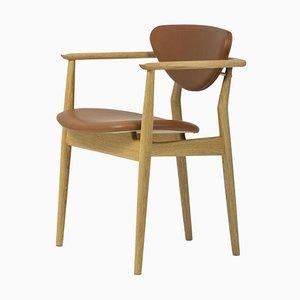 Silla 109 de madera y cuero de Finn Juhl